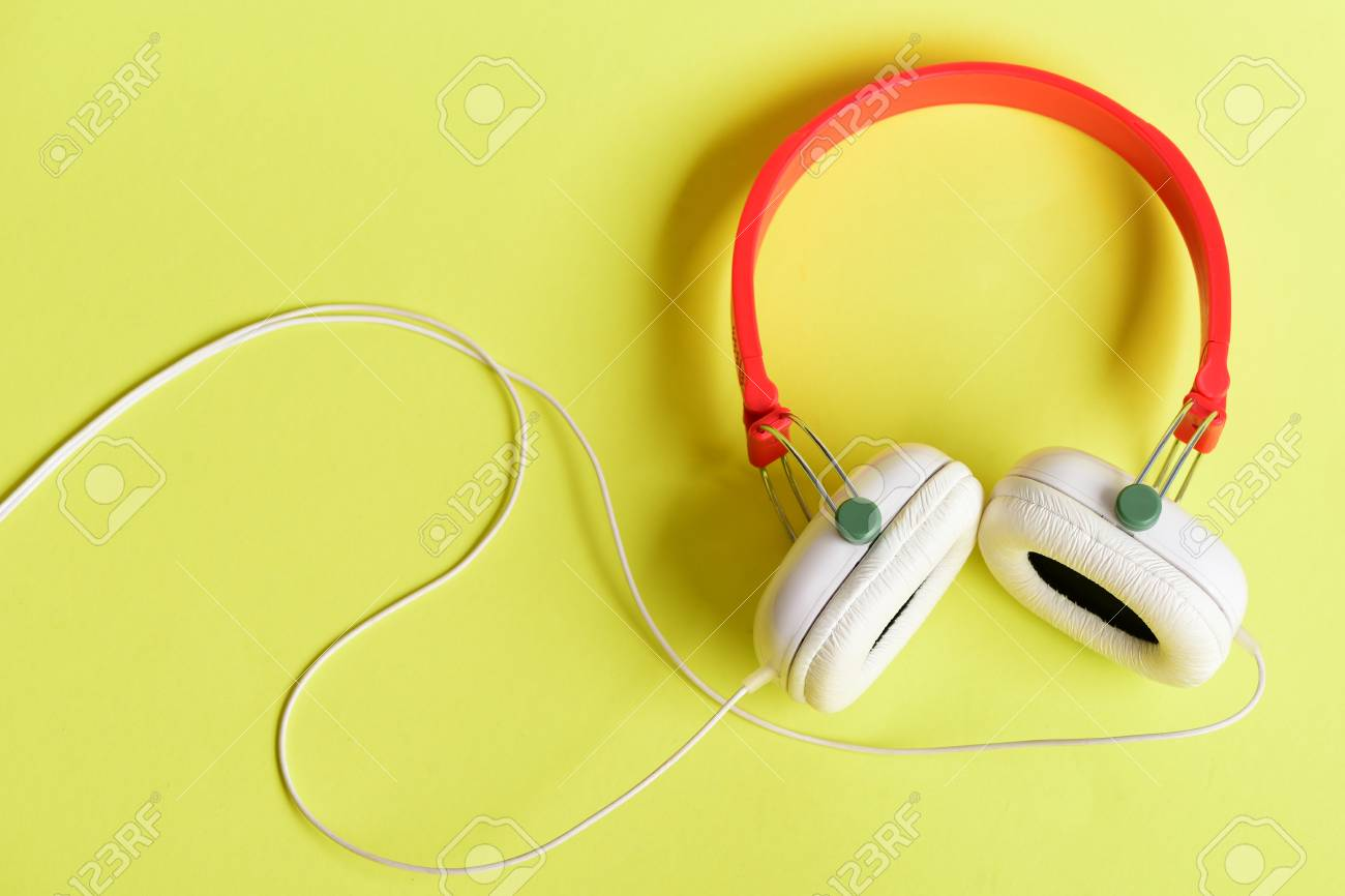 Modern And Stylish Earphones On Yellow Background Top View Stock Headphone Music Headset For Made Of