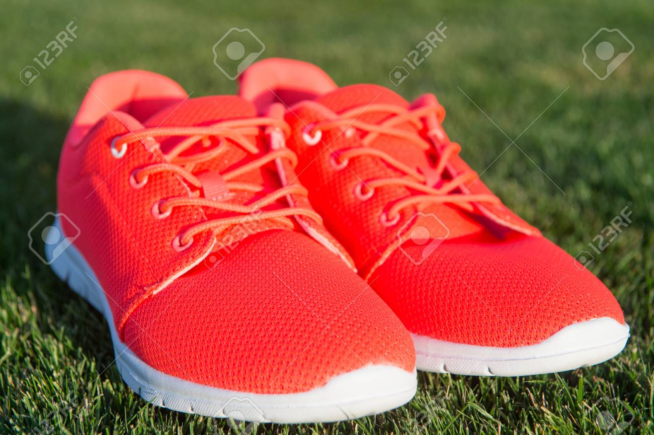 Sports Shoes Sneakers On Fresh Green Grass. Sports In The Open ...