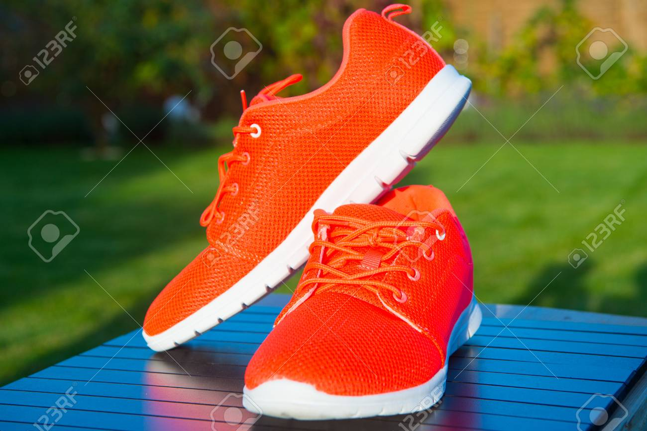 Sports Shoes Sneakers Bright Orange Color. Sports In The Open ...