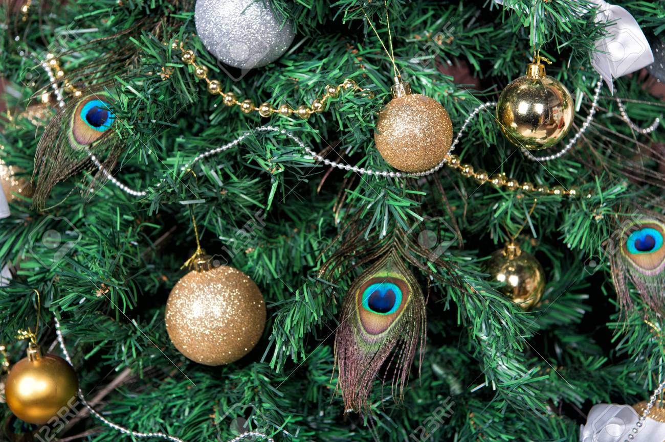 check out b2919 9945a Christmas tree with baubles, peacock feather, garlands on green..