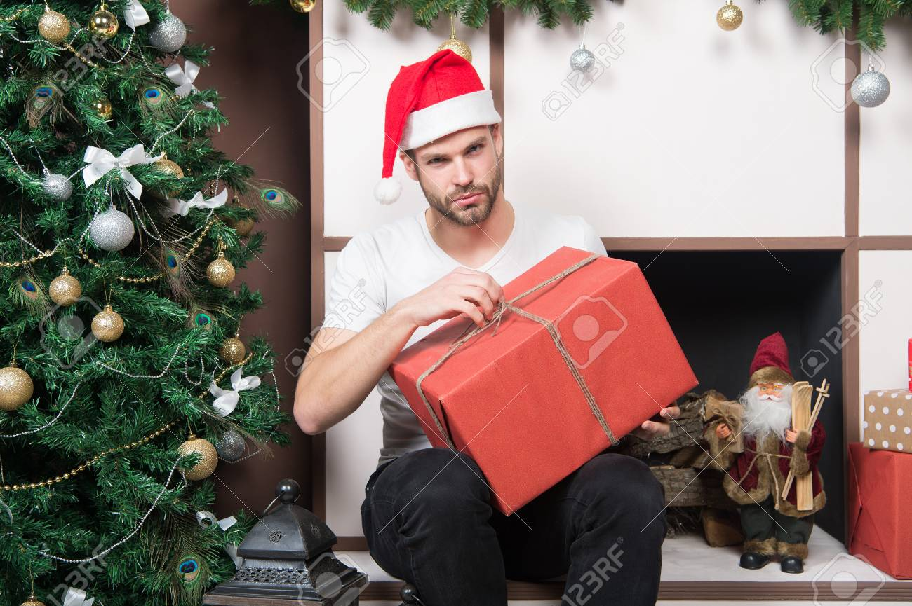 3f068aad2f38f Boxing Day Concept. Man With Present Box At Christmas Tree. Macho ...