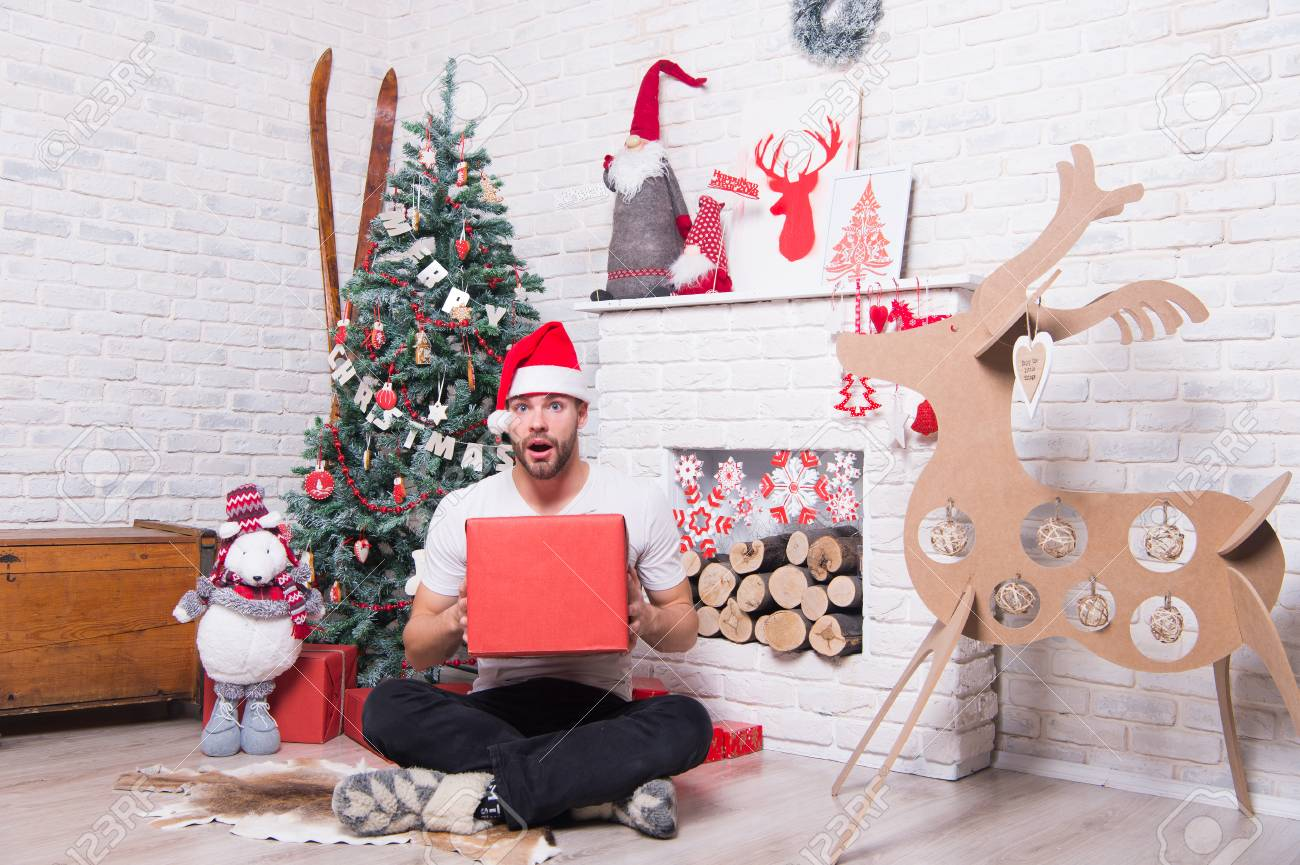 c43b2d6039617 Happy Holidays Celebration. Man In Santa Hat Sit On Floor At.. Stock ...