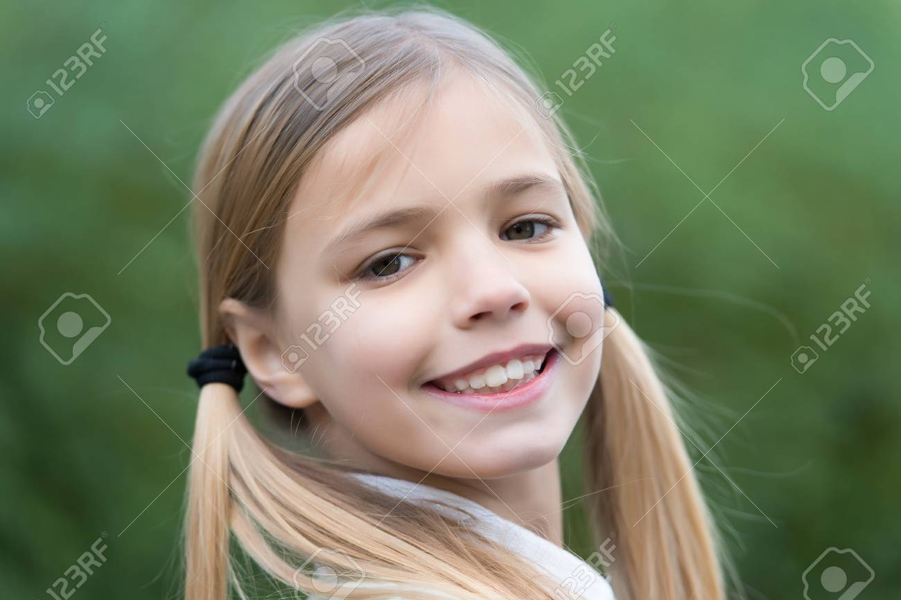 Strange Little Girl Smile On Natural Background Childhood Child With Natural Hairstyles Runnerswayorg