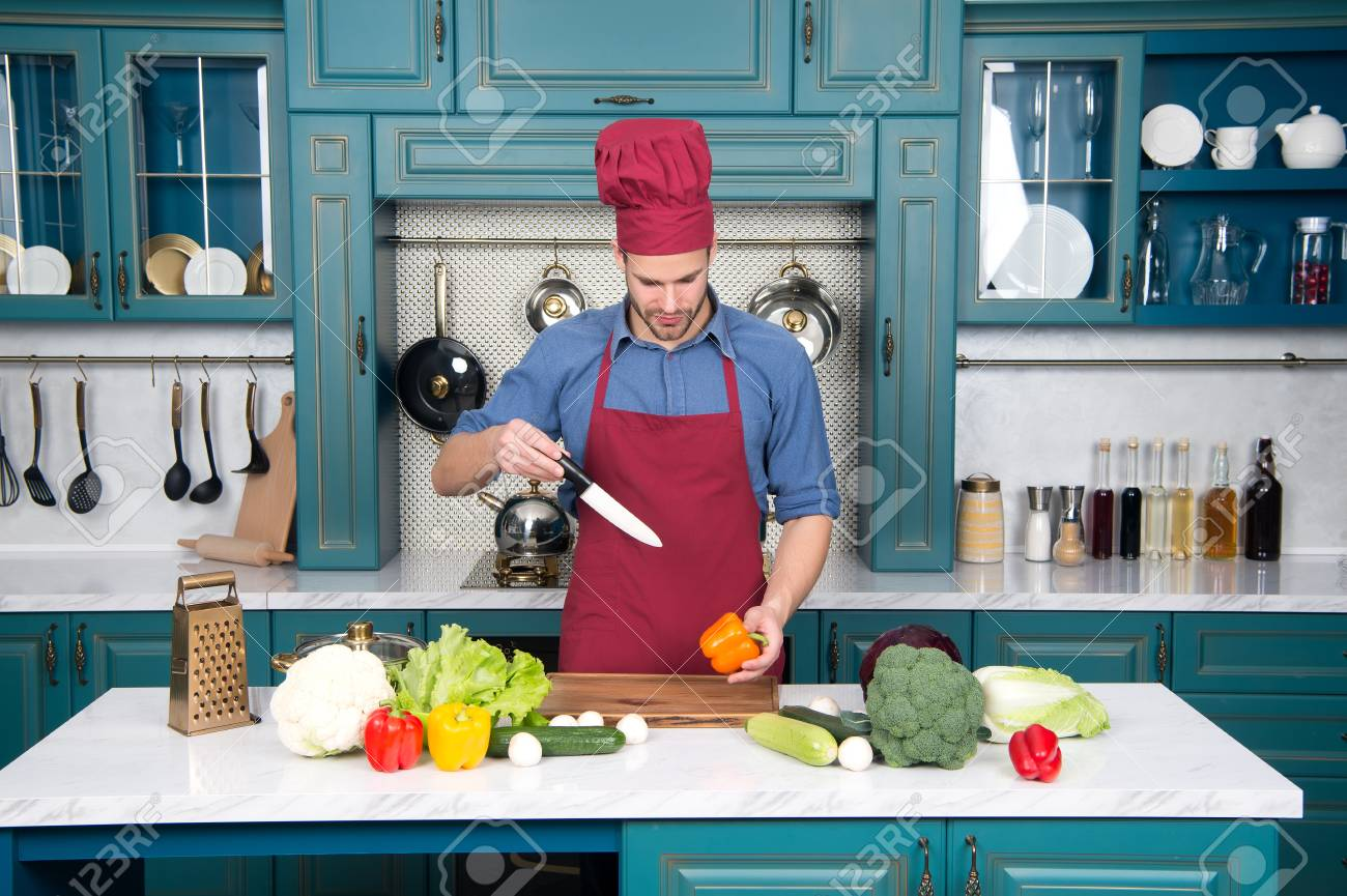 Chef Cooking Food In Kitchen. Chef Man In Hat, Apron Cook With ...