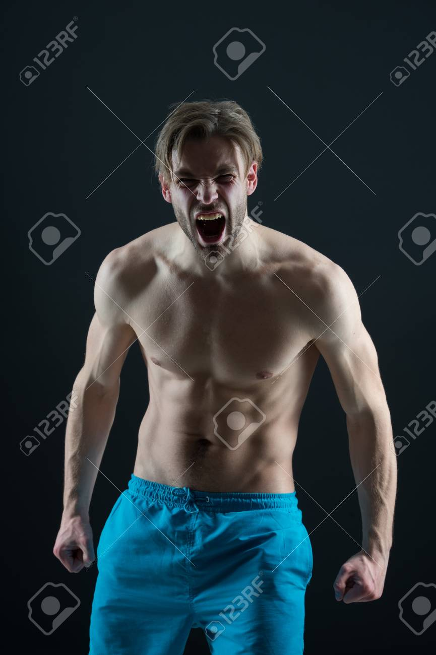 Bearded man shout with anger, health  Angry macho with fit bare