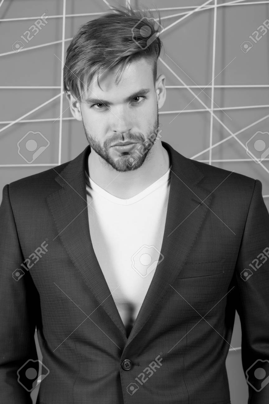 Businessman with bearded face, hair, haircut. Man in formal suit..