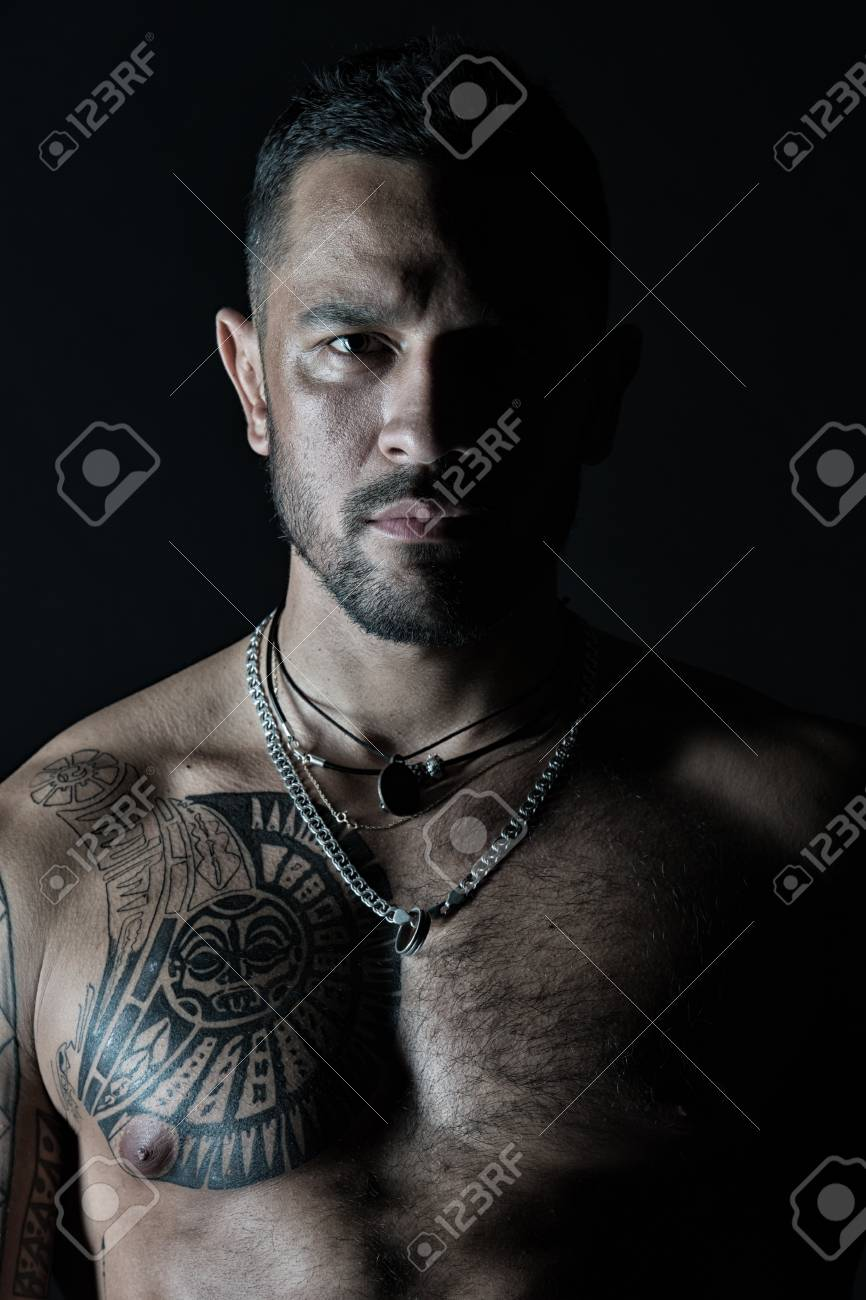 8747aac13 Bearded man with tattooed chest. Macho with sexy bare torso. Fit model with  tattoo
