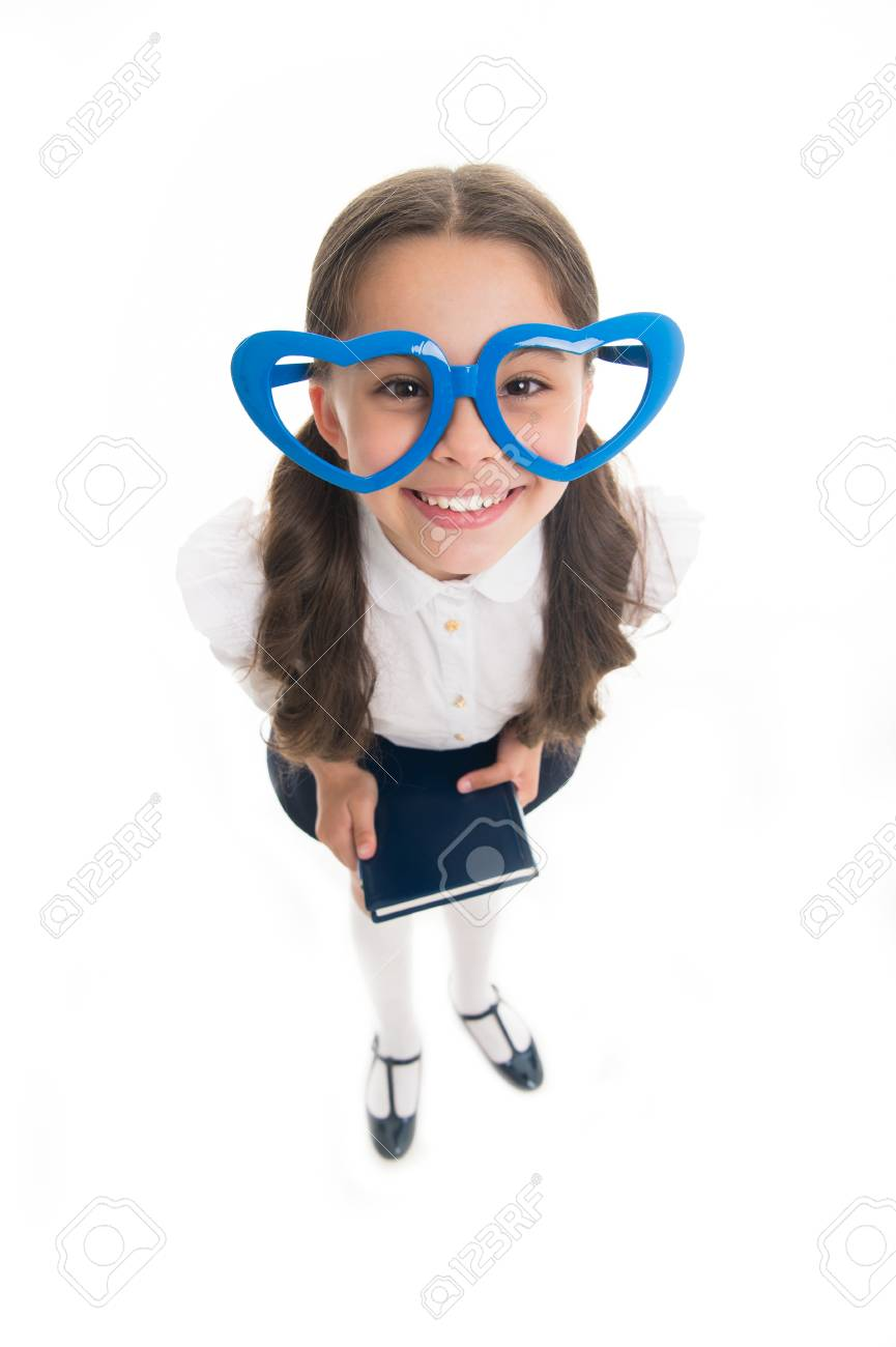 7a5f34e4c0ea2 Girl cute big heart shaped glasses isolated white background. Child girl  school uniform clothes holds