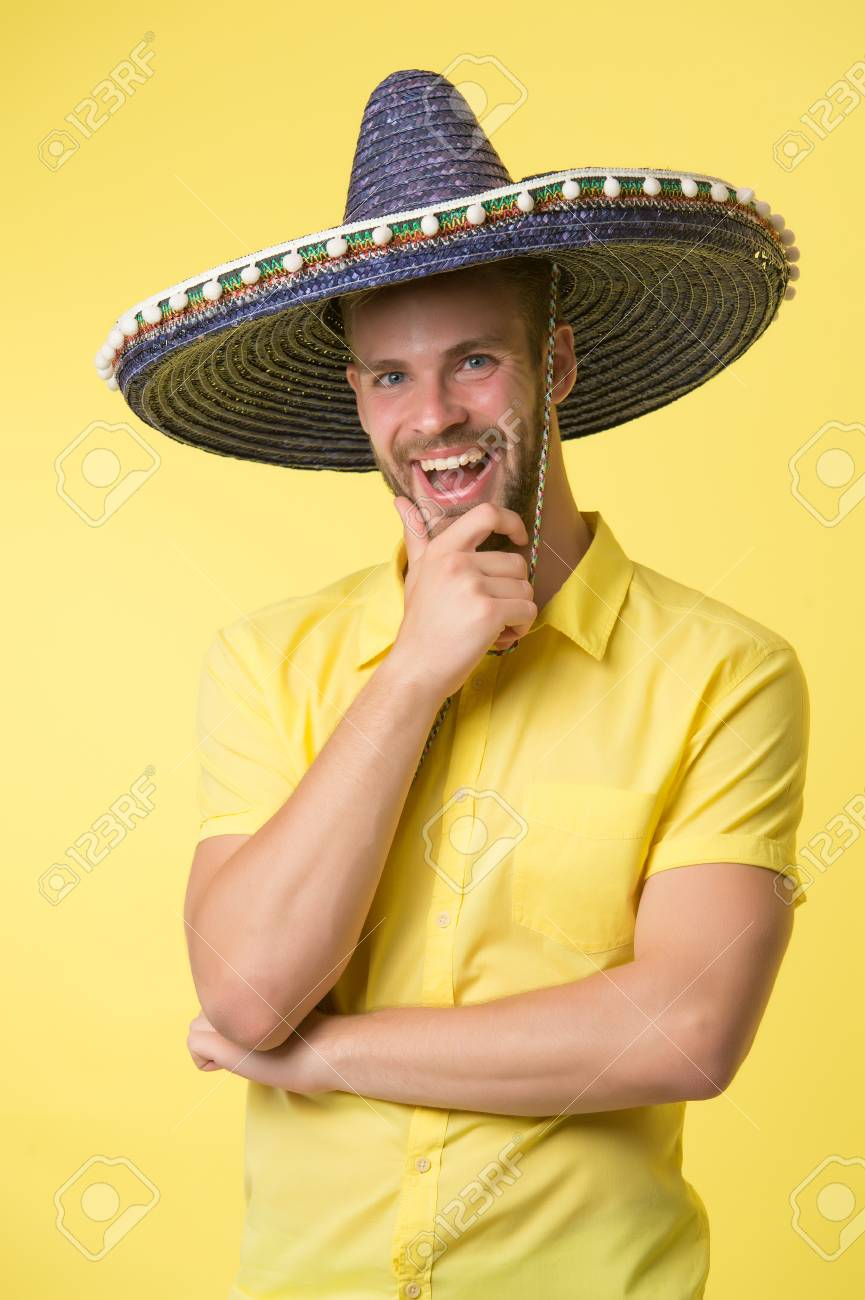 70be0cd1b2b Happy guy smile in sombrero hat. Male fashion. Always in good mood. Mexican