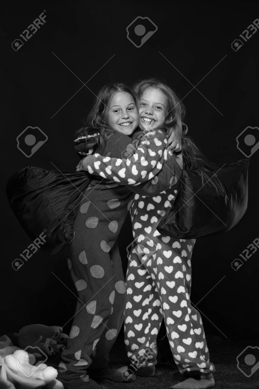 36433a7ce Girls With Happy Faces Hugging Tight. Kids Wearing Red Jammies ...