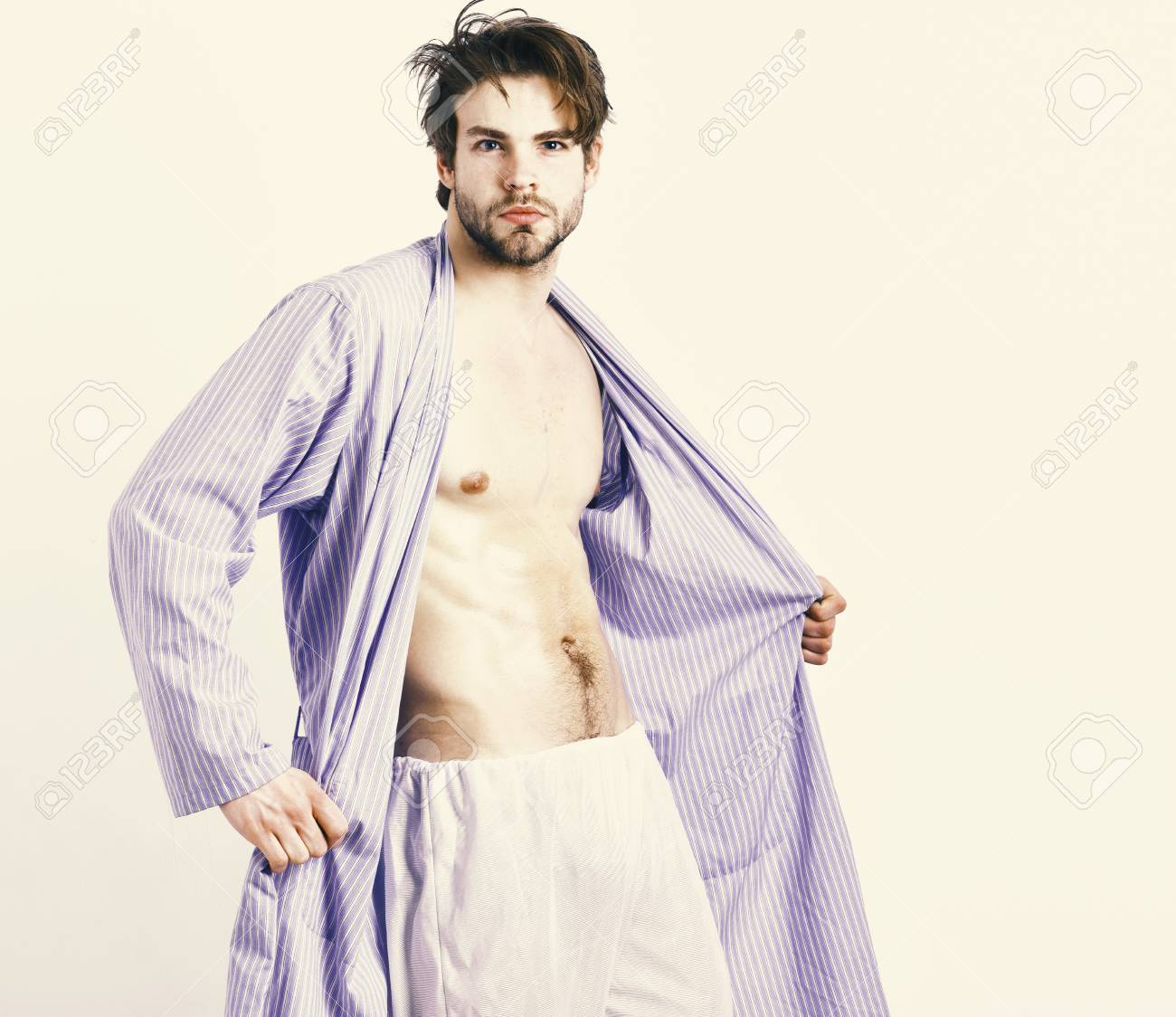Fit Guy With Torso And Six Packs In Blue Bathrobe. Man With Beard ...