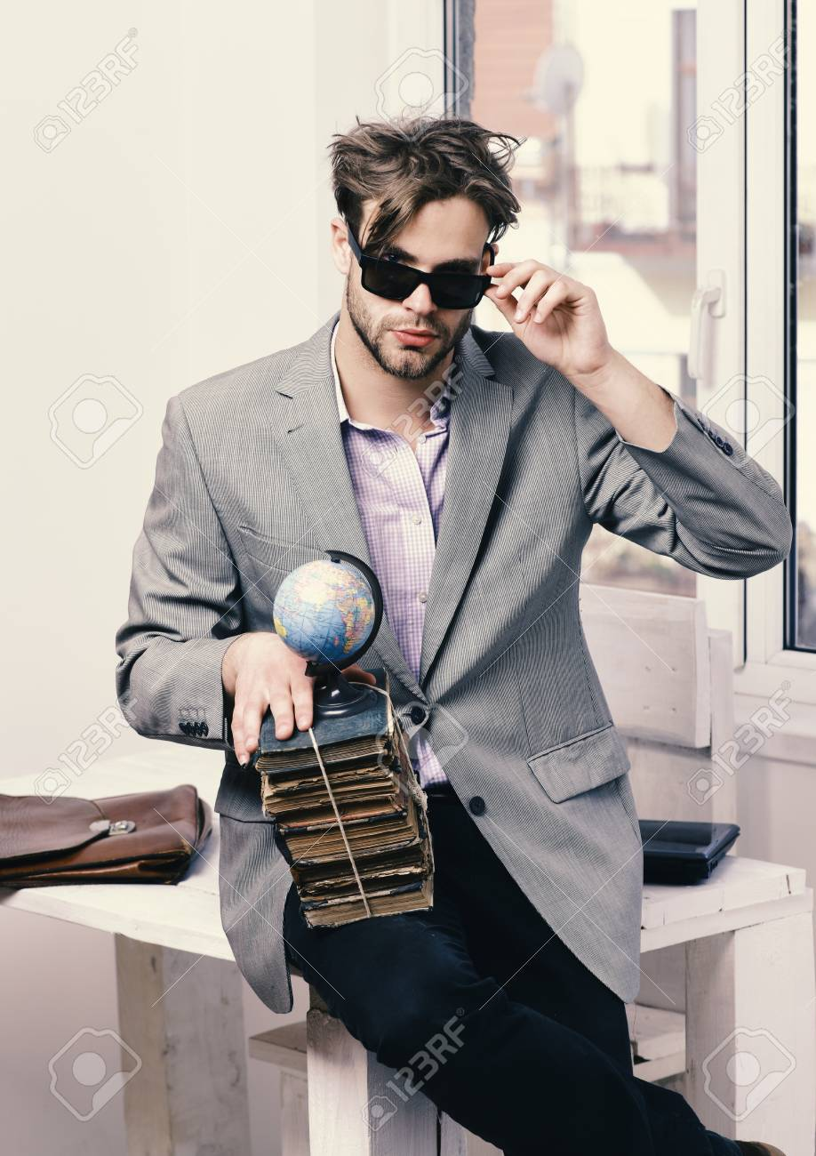 Brilliant Cool Guy Wearing Suit Sits On Table Businessman With Pile Of Download Free Architecture Designs Rallybritishbridgeorg
