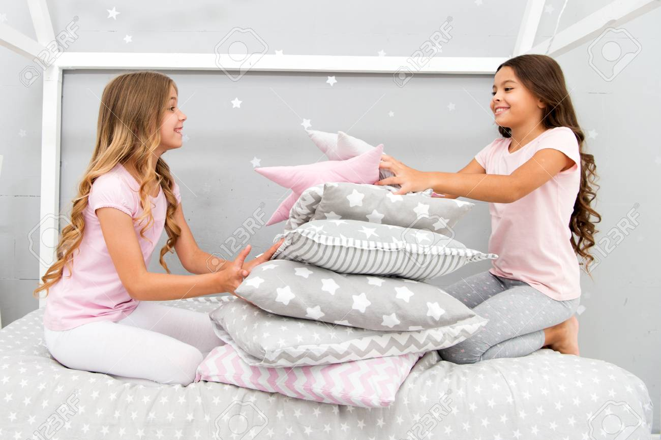 b2fc88de4e Girls happy best friends in pajamas with pillows sleepover party. Soulmates  girls having fun sleepover