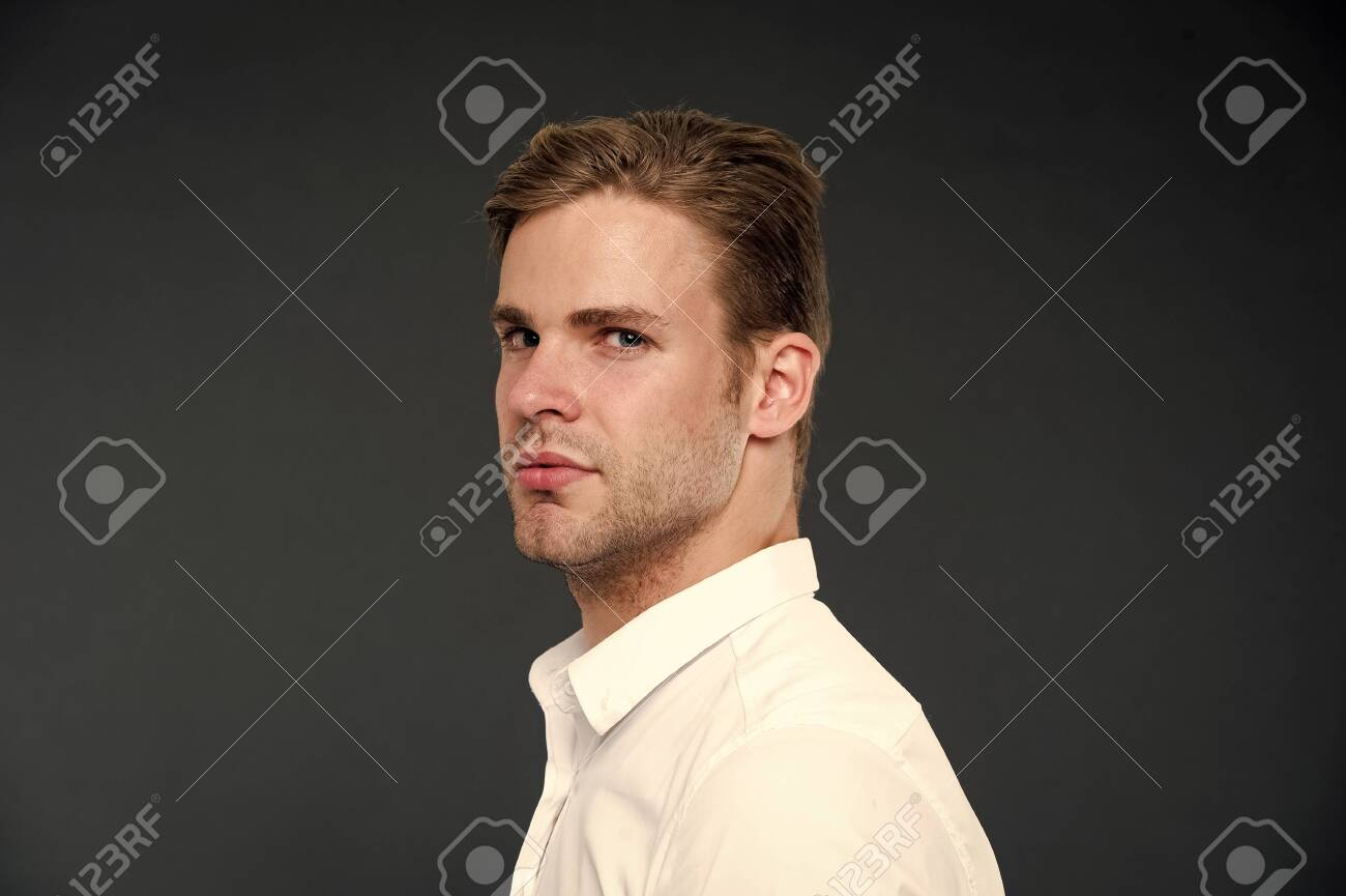 Confidence and masculinity. Guy confident in his appearance. Man well groomed with bristle and hairstyle dark background. Macho confident strict face close up. Guy handsome attractive white shirt. - 123039854