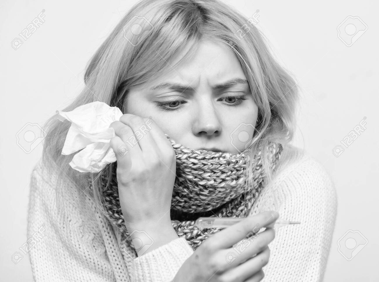 Seasonal flu concept. Woman feels badly. How to bring fever down. Fever symptoms and causes. Sick girl with fever. Girl sick hold thermometer and tissue. Measure temperature. Break fever remedies - 128935448