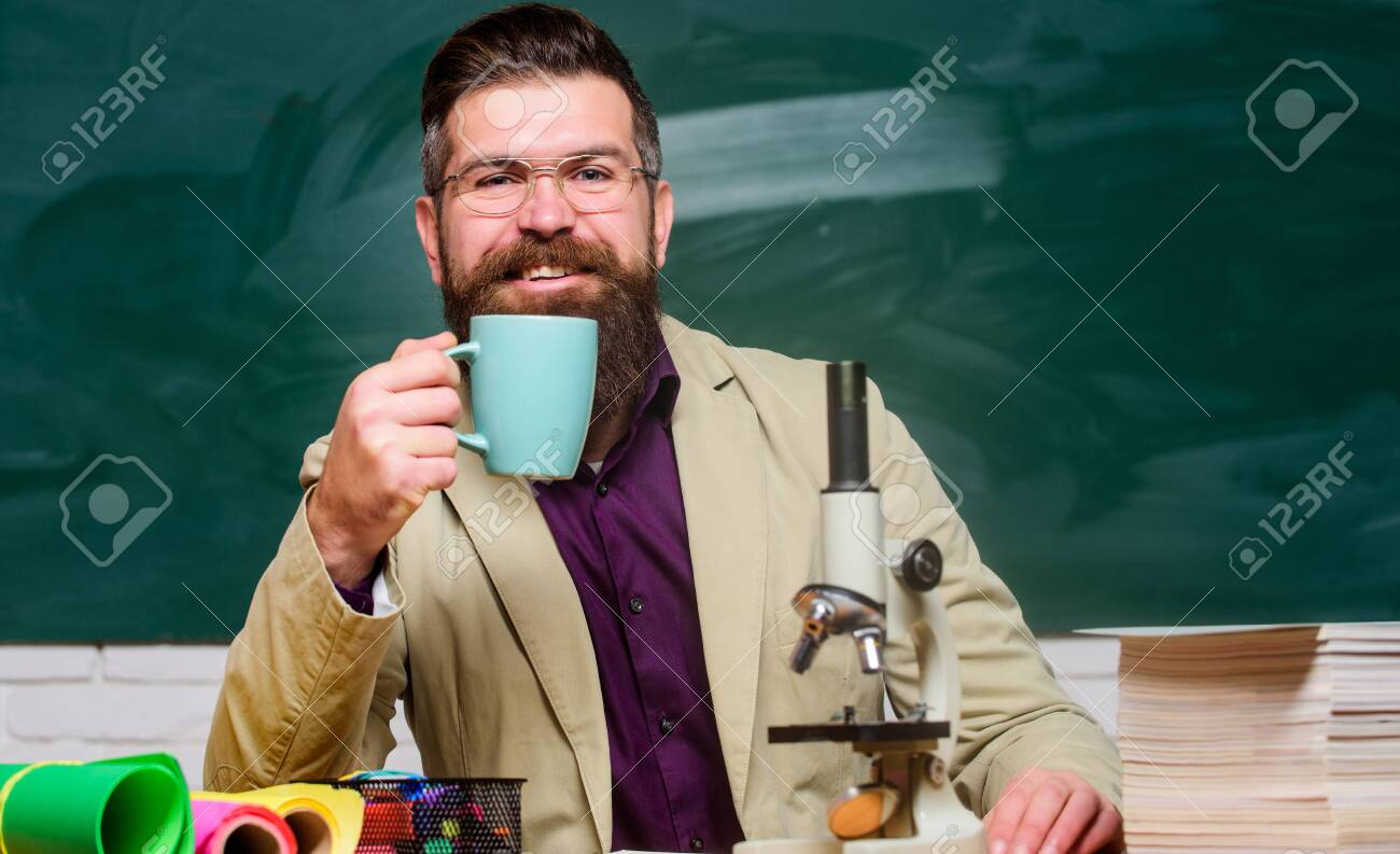 chemistry lesson. mature teacher at blackboard. Towards knowledge. good morning coffee. back to school. using microscope. biology education. happy bearded man hipster drink tea at school - 136794441