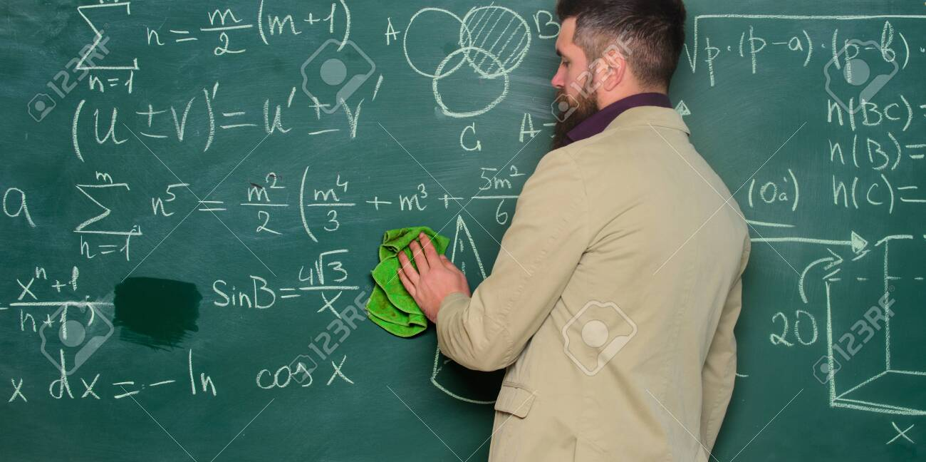 Prepare for lesson. Teacher bearded man cleaning chalkboard background. Teacher wiping chalkboard. School principal. Demanding teacher. Lecturer in classroom. Explaining theory. Teacher hold rag - 137460144