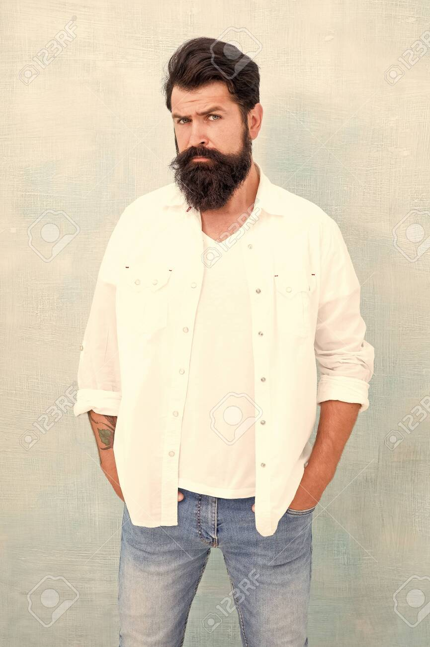 handsome hipster jeans. male fashion and beauty. Masculinity concept. Summer season fashion trend. brutal macho gray background. Male temper brutality. bearded man radiate masculinity - 139456382