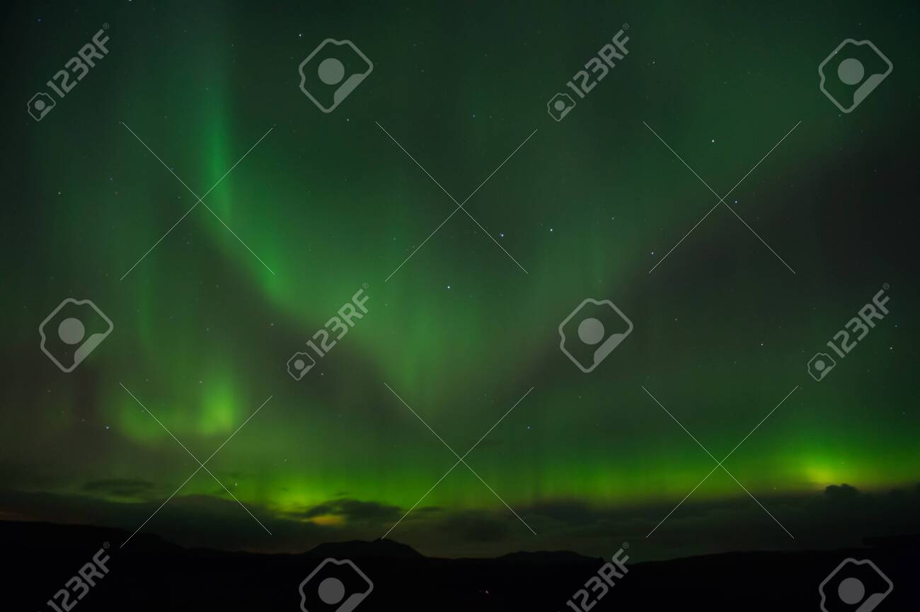 Nature miracles. Aurora dark sky. Amazing nature phenomena. Best place see aurora borealis. When is best time to see northern lights. Place to see northern lights. Northern light black sky with stars. - 140212437