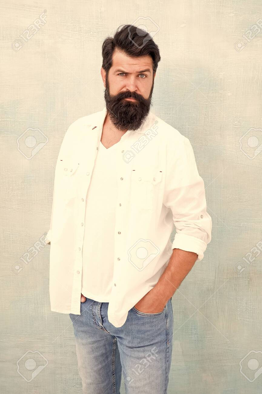 Facial care. bearded man radiate masculinity. handsome hipster jeans. male fashion beauty. Masculinity concept. Summer season fashion trend. brutal macho gray background. Male temper brutality - 141010166