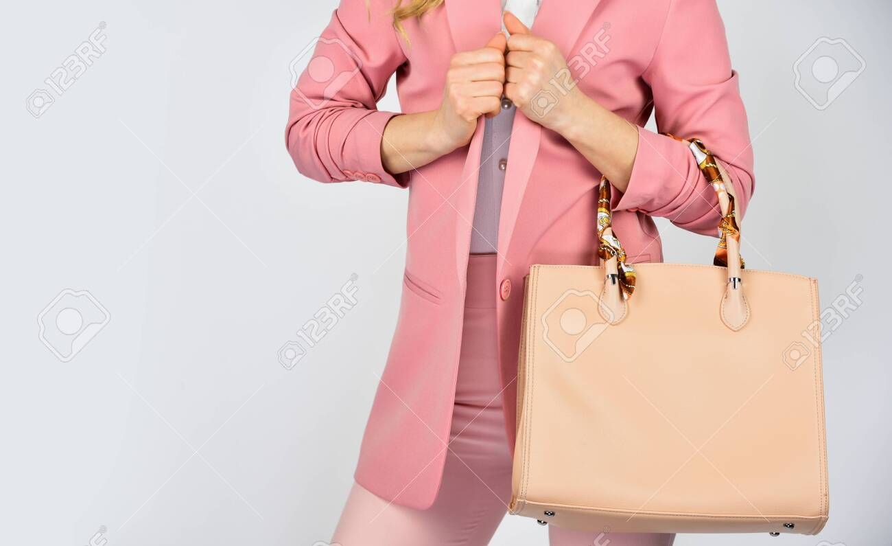 need to serve its purpose. woman use leather clutch. girl weal pink formal jacket. confident carry shoulder bag. handbag fashion and beauty. tote or shopper bag for any occasion. copy space. - 145165778
