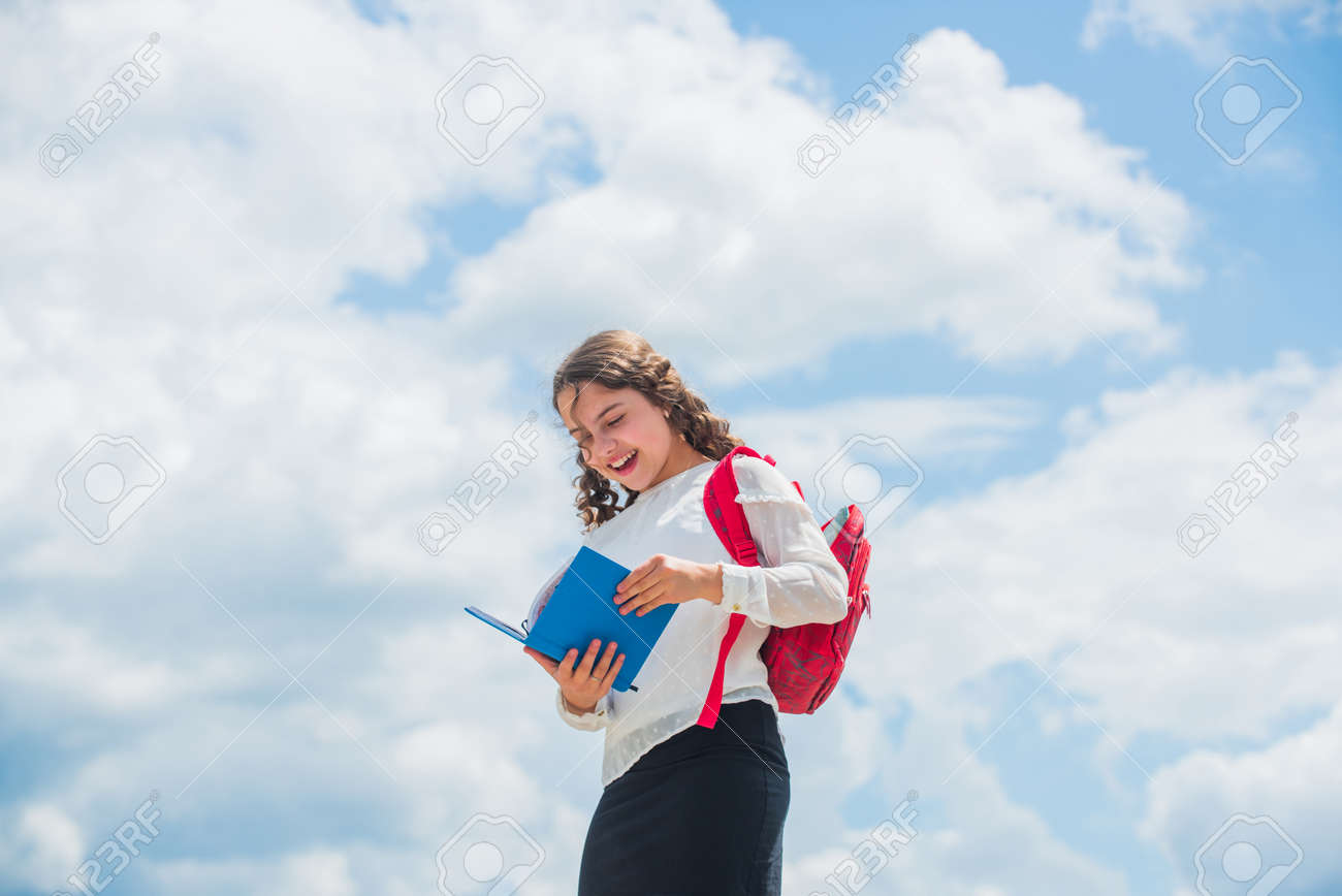 Back to school. Little child going to school. Knowledge day. Outdoors classes. Successful schoolgirl. Your chance for successful future. Free education. Happy girl with school backpack sky background - 154102026