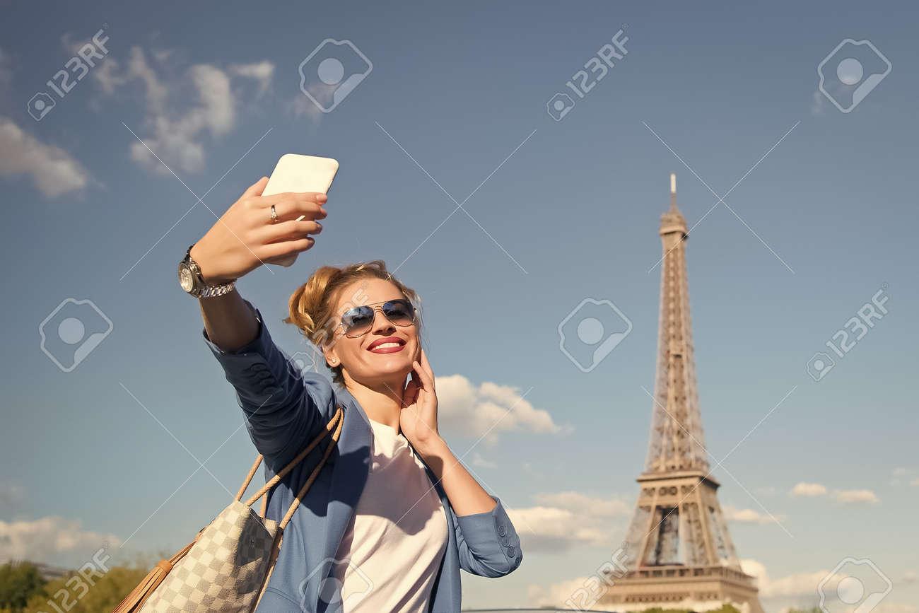 girl making selfie front of Eiffel Tower in Paris, France. - 158430654