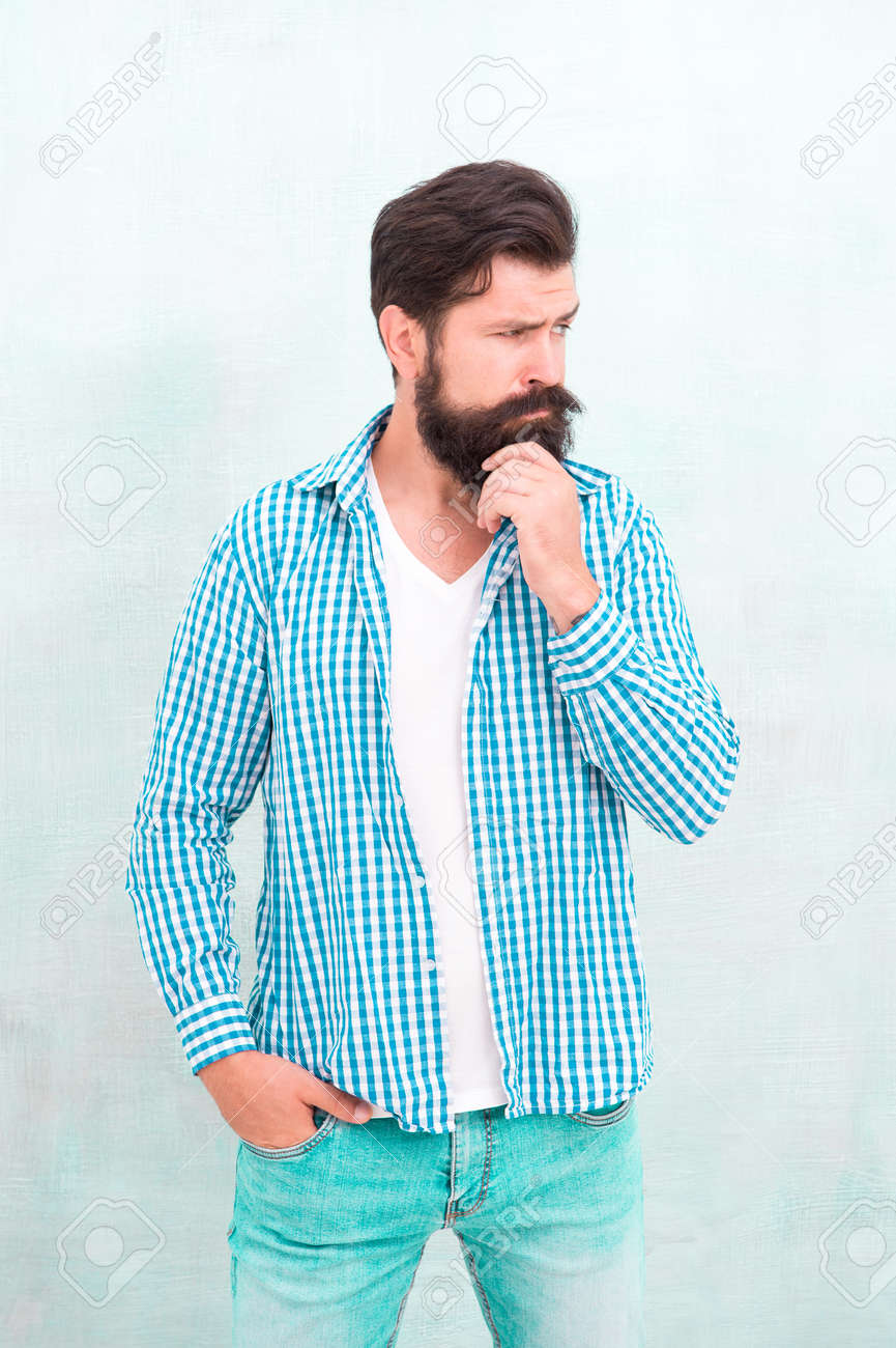 Attractiveness concept. Well groomed guy. Brutal handsome hipster man grey wall background. Bearded man trendy hipster style. Masculinity and male beauty. Hipster with beard and mustache wear shirt - 160697108