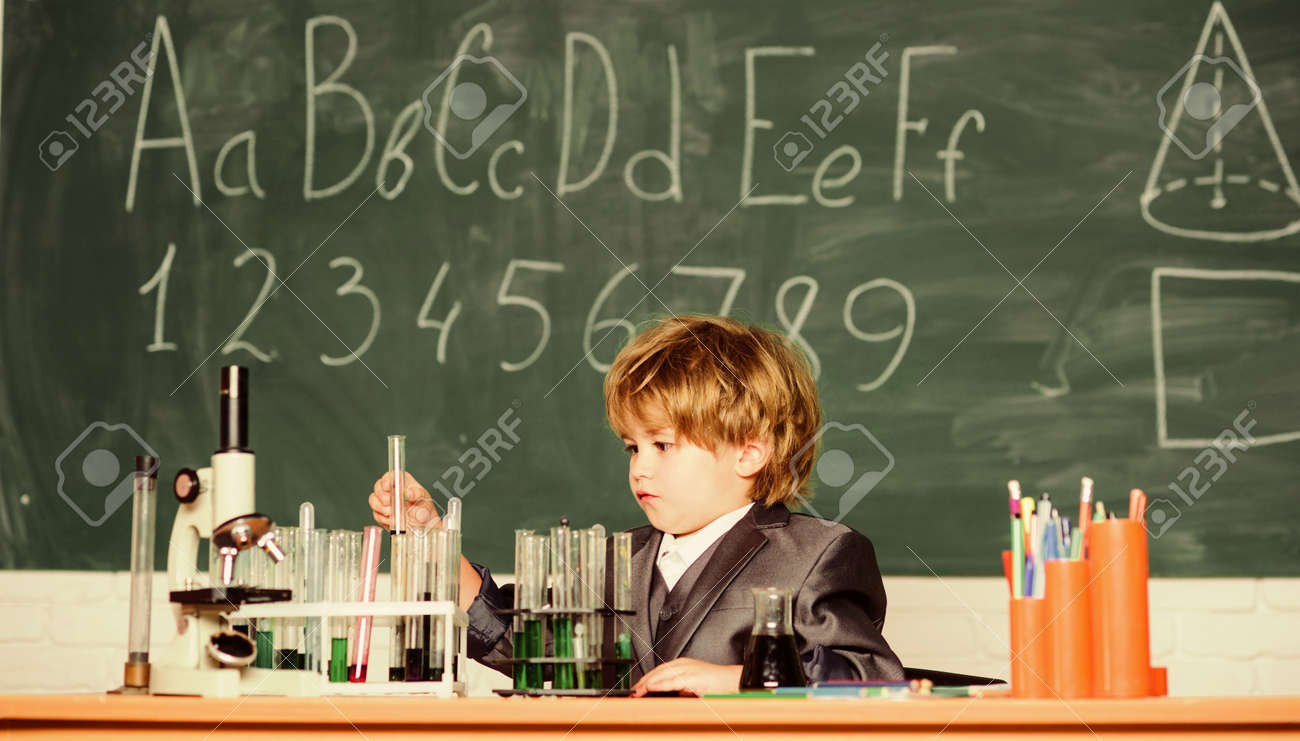 Little boy is making science experiments. little boy at lesson. Back to school. biology science. school kid scientist studying science. experiments with microscope in lab. Using modern technologies - 164558357