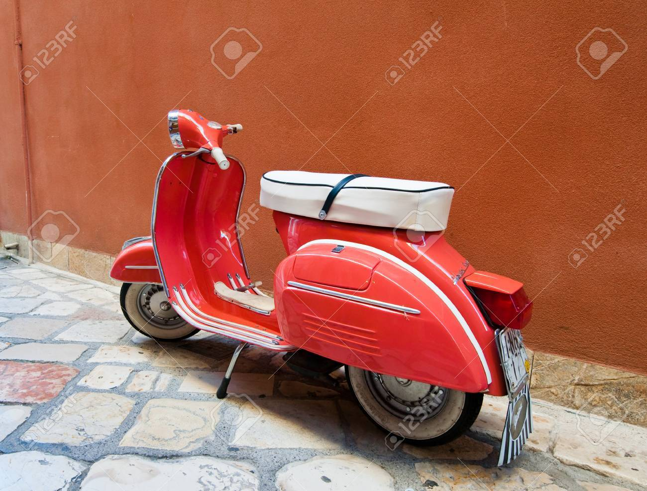 CORFU-AUGUST 22: Vintage Vespa scooter parked on Kerkyra street