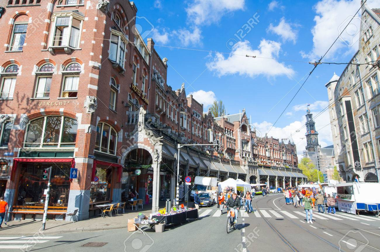 AMSTERDAMNETHERLANDSAPRIL 27  Raadhuisstraat street on King39s Day with  Western Church on the background on April. AMSTERDAMNETHERLANDSAPRIL 27  Raadhuisstraat Street On King39s