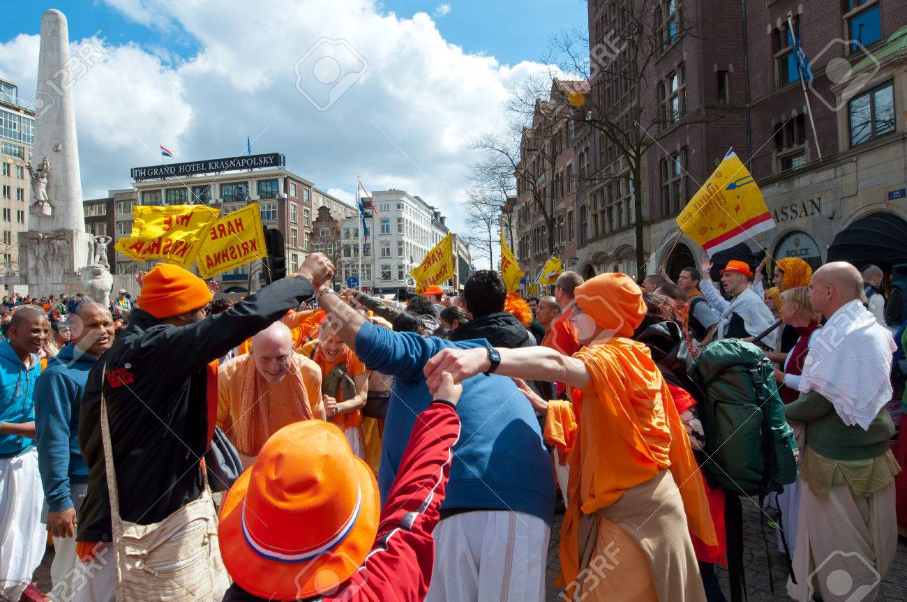 AMSTERDAM NETHERLANDS APRIL 27  Locals and tourists in orange clothes  celebrate King39s Day on April. AMSTERDAM NETHERLANDS APRIL 27  Locals And Tourists In Orange