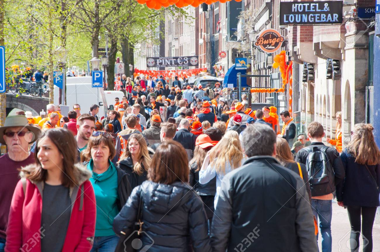 AMSTERDAM NETHERLANDS APRIL 27  Busy street around red light district on  King39s Day on April. AMSTERDAM NETHERLANDS APRIL 27  Busy Street Around Red Light