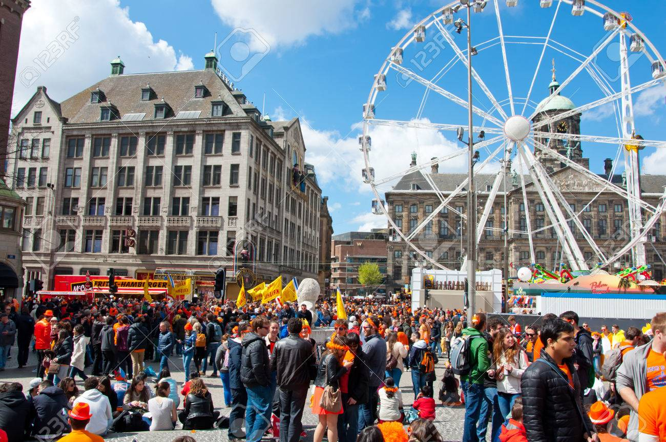 AMSTERDAM APRIL 27  Crowd of people on Dam Square and Royal Palace on the  background. AMSTERDAM APRIL 27  Crowd Of People On Dam Square And Royal Palace