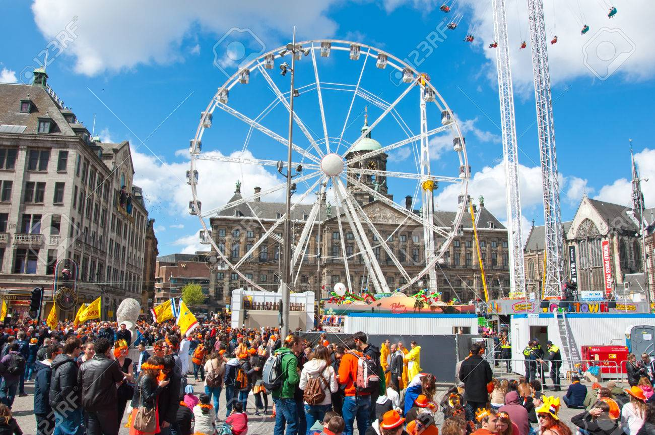 AMSTERDAM APRIL 27  Dam Square with Ferris wheel and Royal Palace on the  background during. AMSTERDAM APRIL 27  Dam Square With Ferris Wheel And Royal Palace