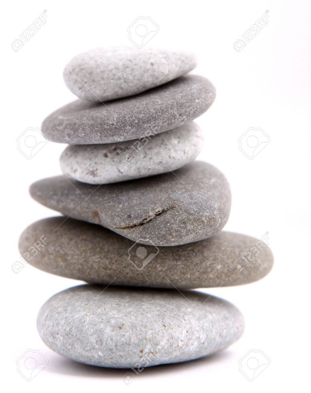 Balancing stones isolated on a white Stock Photo - 10018756