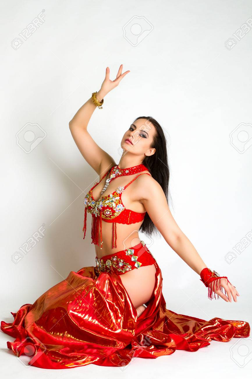 078c8b1bc61e Beautiful Young Girl In A Red Suit Oriental Dance In Motion Isolated ...