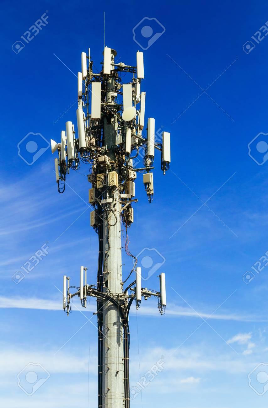 communications tower Antenna tower against sunburst  Smart phone
