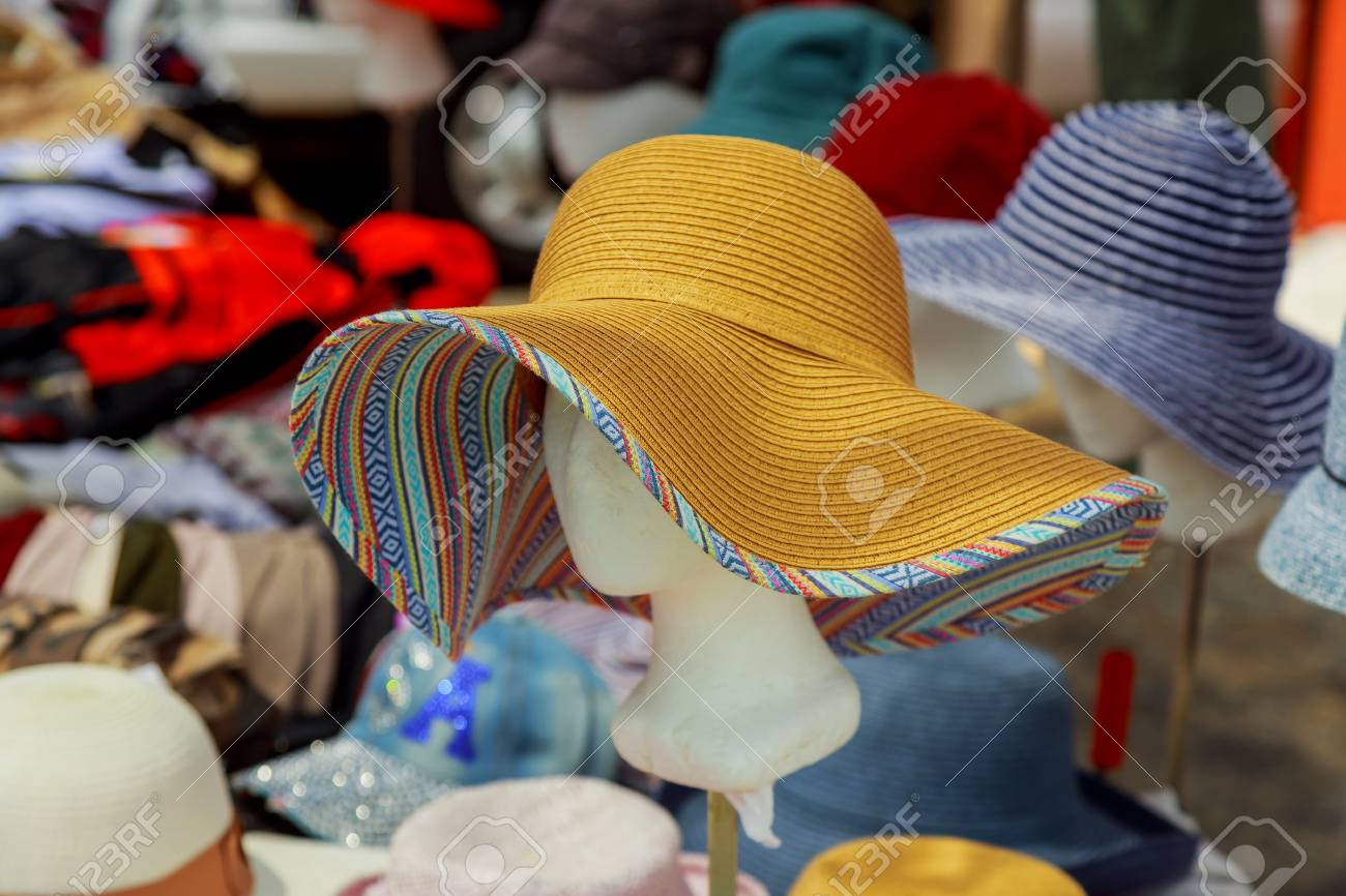 Ladies Summer hats for sale at a local market. Stock Photo - 77295834 5b7f9de070b