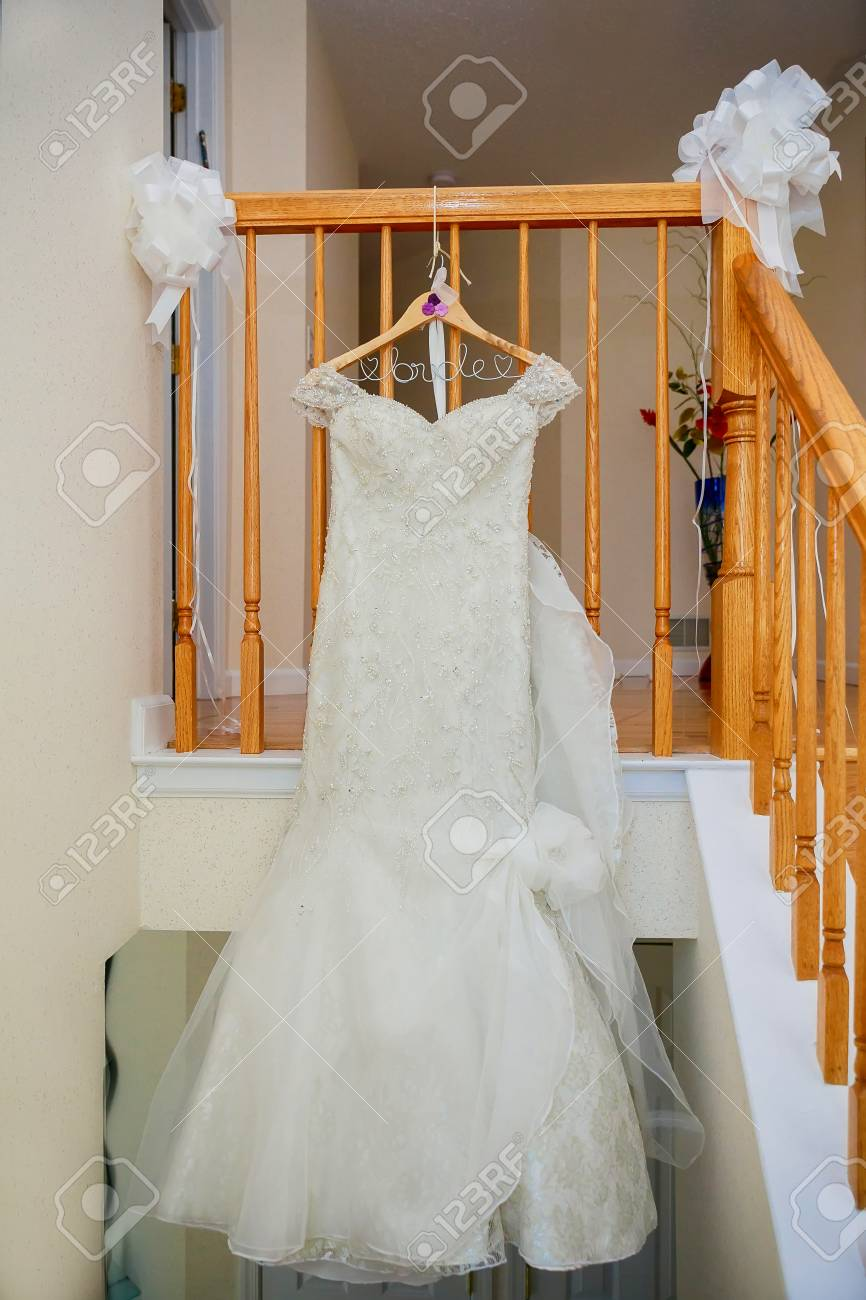 The Perfect Wedding Dress With A Full Skirt On A Hanger In The