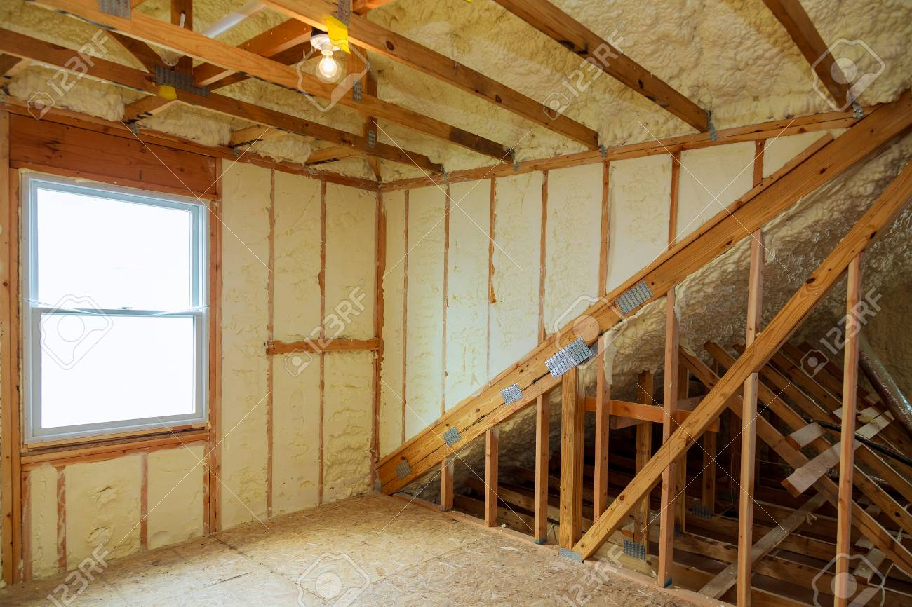 A room at a newly constructed home is sprayed with liquid insulating foam - 90015740