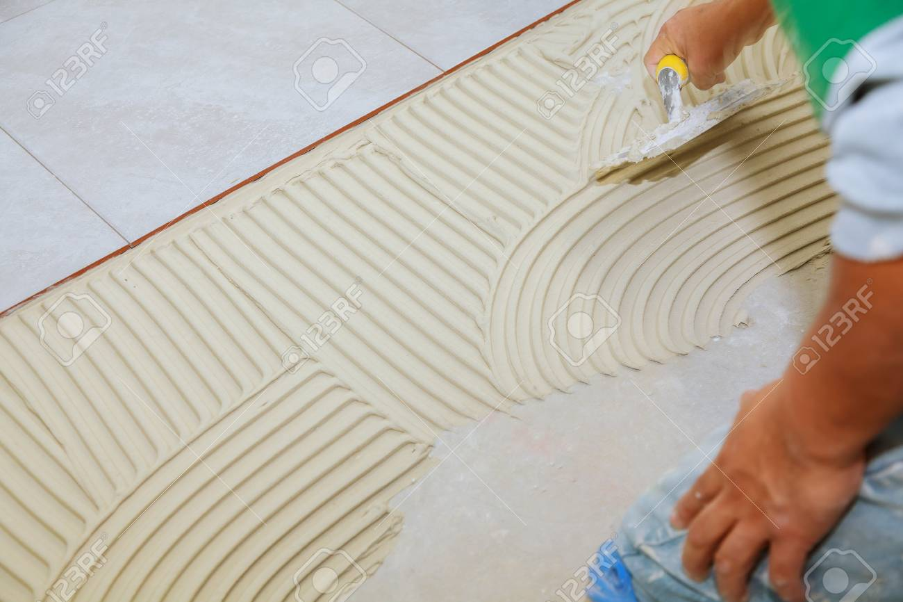 Master Puts Adhesive Spreading Wet Mortar Before Applying Tiles ...