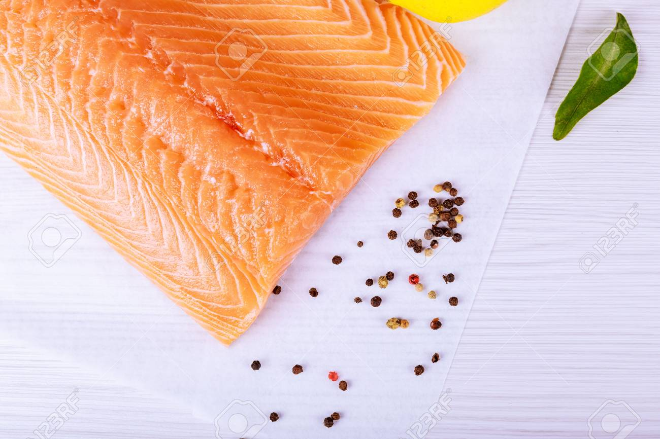 Salmon on a wooden board . Selective focus Fish and seafood: Salmon, skin side down - 96457653