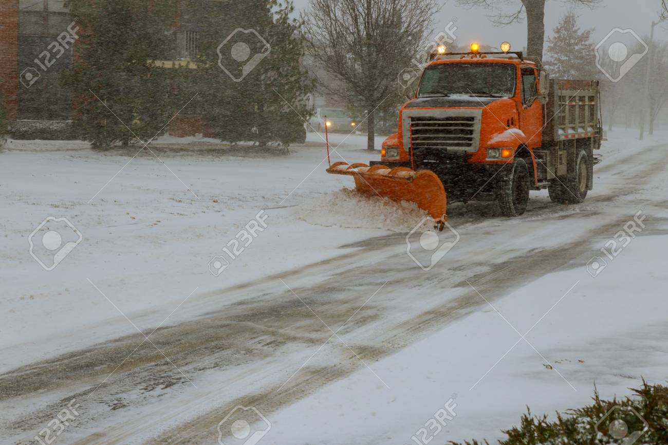 Clearing the road from street during snow blizzard - 112151787