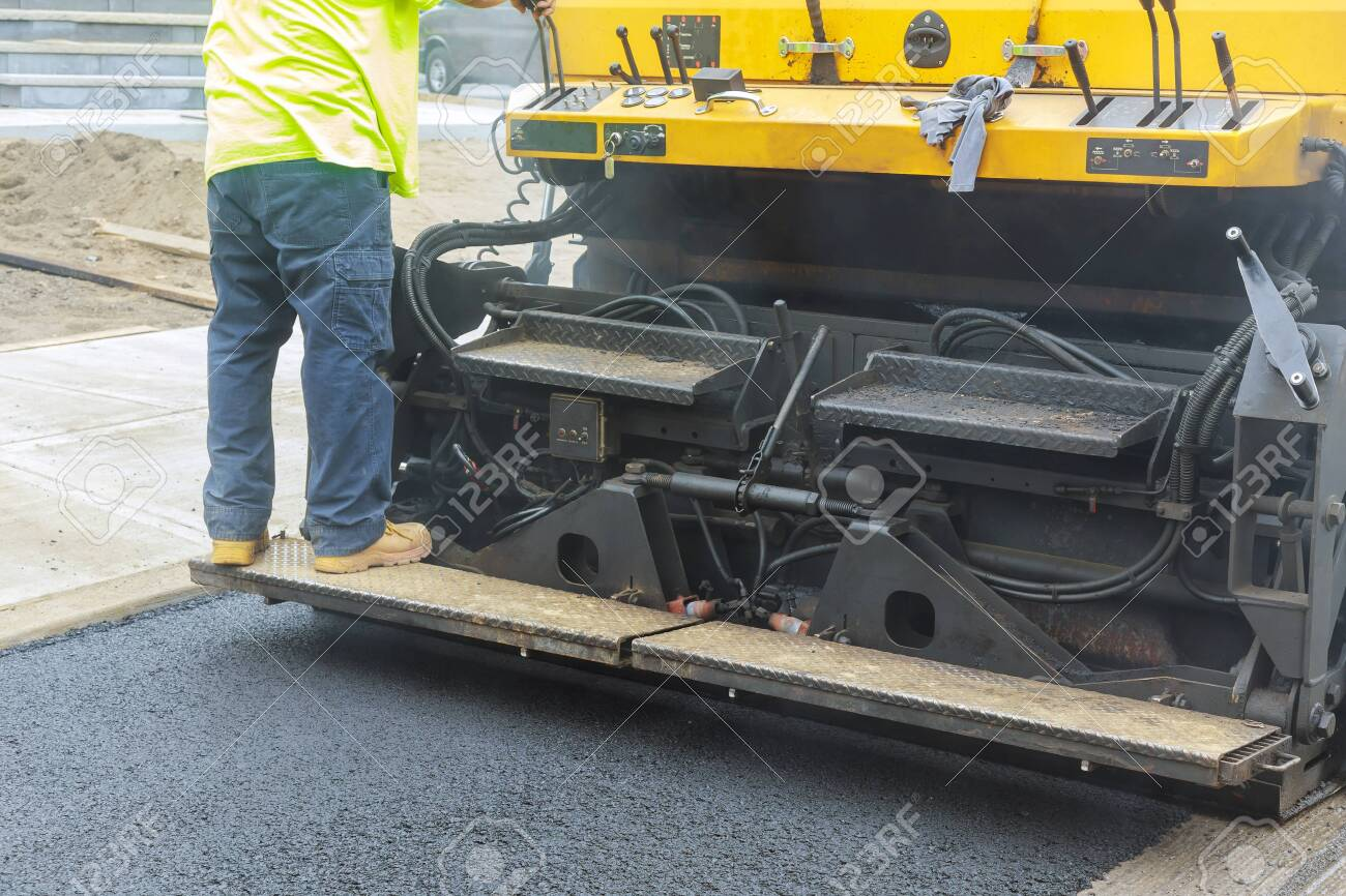 Asphalt paver machine during road construction, road construction the first layer of asphalt. - 143948305
