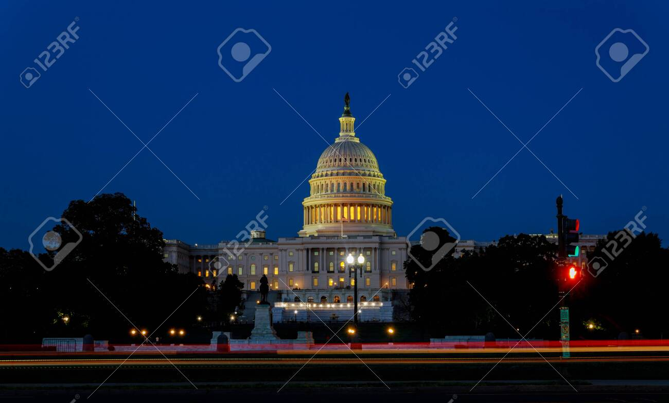 The United States Capitol building with the dome lit up at night the Senate House sides of the building - 148296688