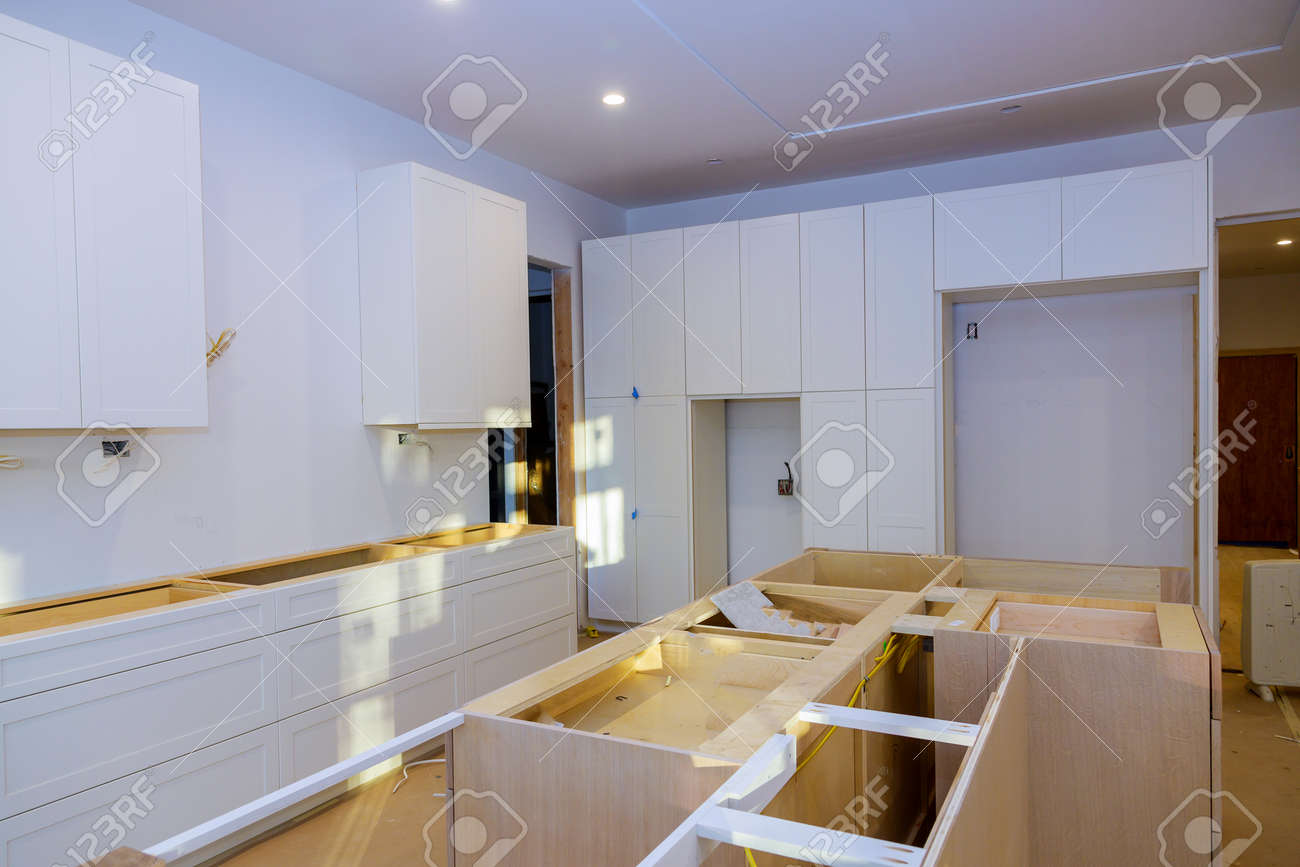 Home improvement installed in a new kitchen of installation base cabinet - 148482125