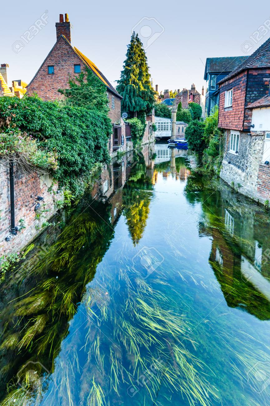 Cityscape with the Great Stour river and old houses in the historic