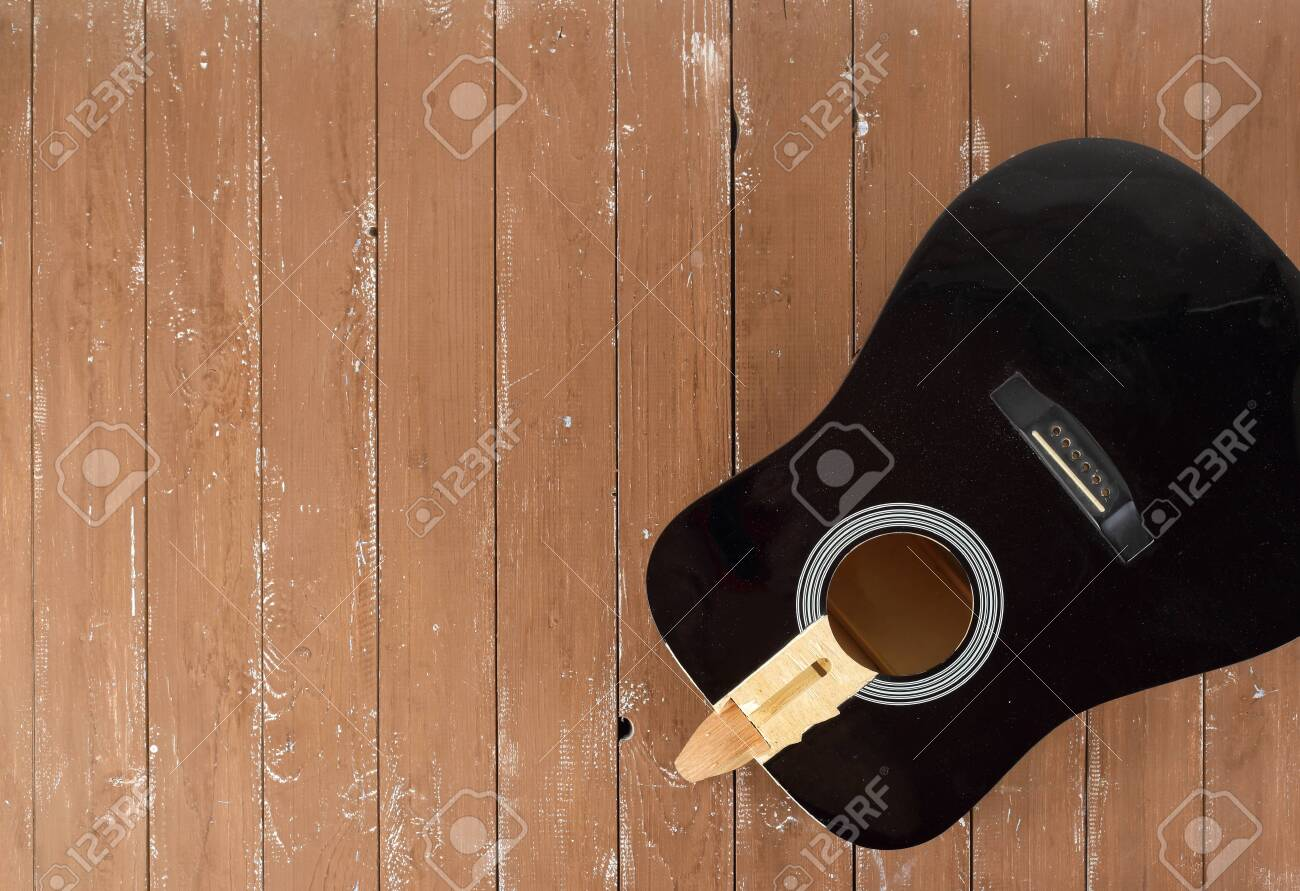 Guitar repair and service - broken sound board acoustic guitar top view wooden background - 128715185