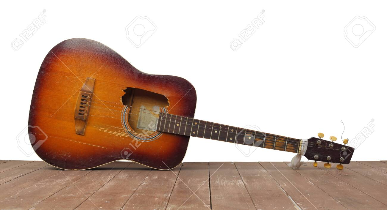Musical instrument - Front view broken classic acoustic guitar on a white wall - 144386390